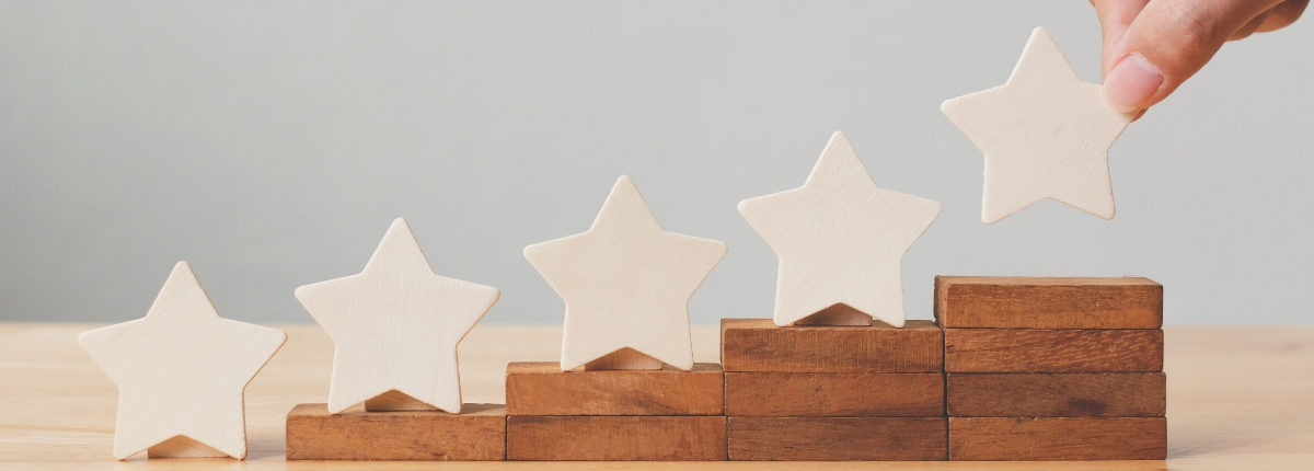 Image of five stars being placed on wooden stair elevations