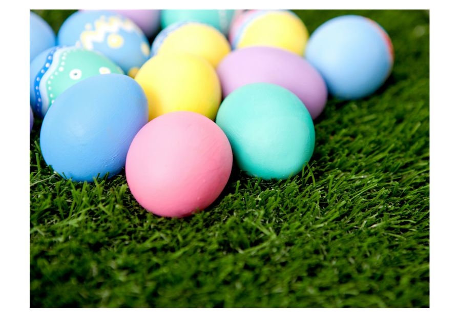 Colorful Easter eggs laying on grass.