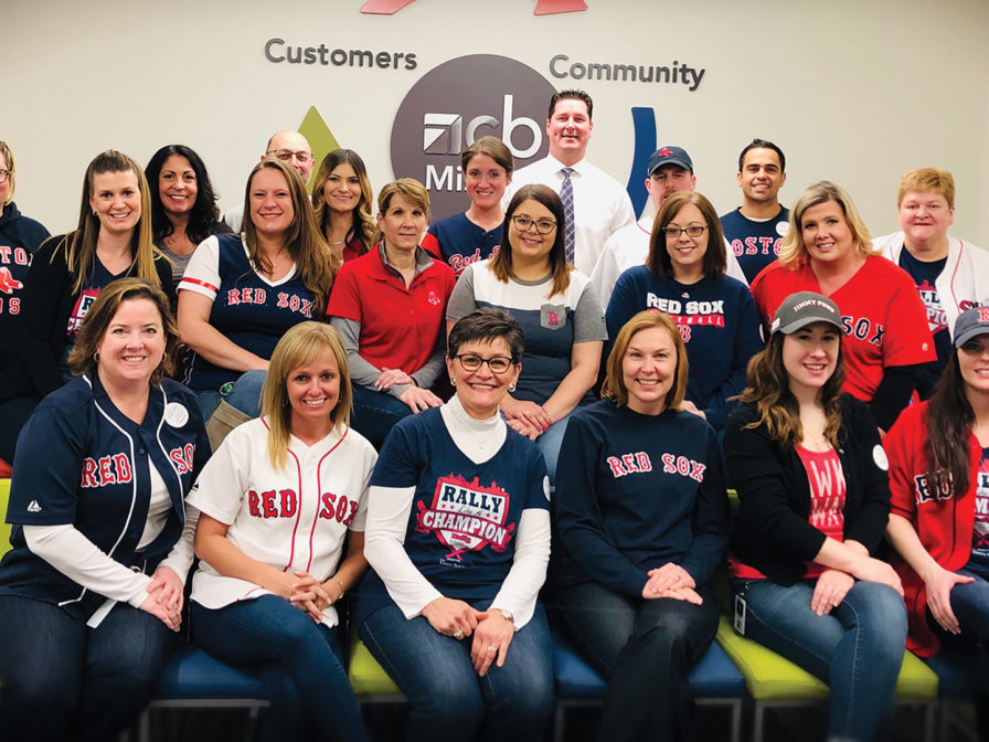 Group photo of Country Bank staff supporting the Jimmy Fund Rally Against Cancer event by wearing Red Sox gear.