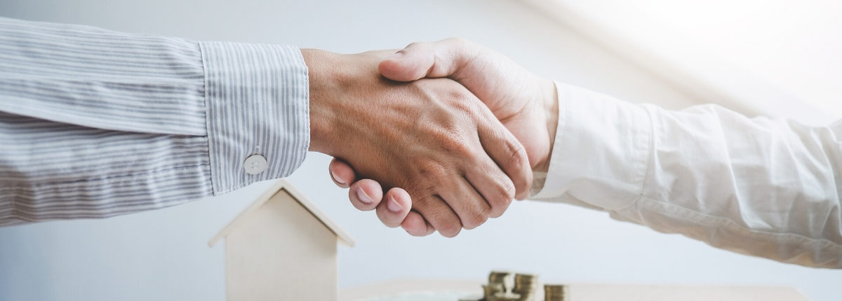 Image of two professionals shaking hands
