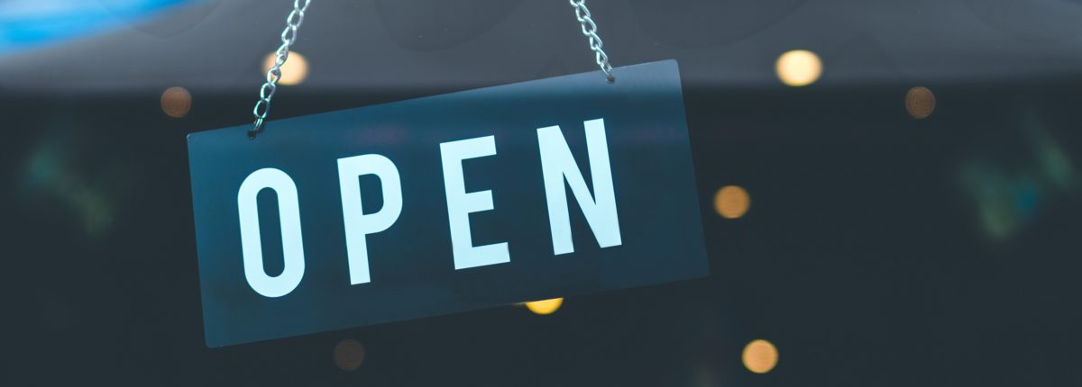 Open sign hanging in the window